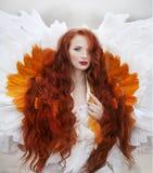 Beautiful girl like a swan on the beach stock photos