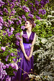 Beautiful girl among lilac Royalty Free Stock Photography