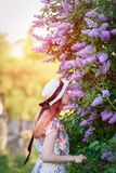 Beautiful girl at the lilac Bush-summer, spring and the concept. Of lifestyle Stock Photos