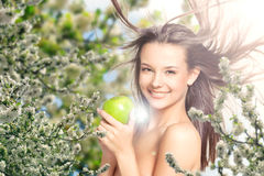 Beautiful girl in the lilac flowers Stock Image