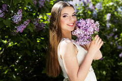 Beautiful girl with a lilac flowers Royalty Free Stock Photo