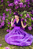 Beautiful girl in lilac garden Royalty Free Stock Image