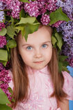 Beautiful girl with the lilac spring wreath Stock Photo