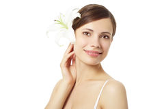 Beautiful girl with lily flower Stock Image