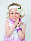Beautiful girl with a lily flower Stock Photography