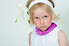 Beautiful girl with a lily flower Stock Images