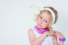 Beautiful girl with a lily flower Stock Photos