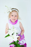 Beautiful girl with a lily flower Royalty Free Stock Photography