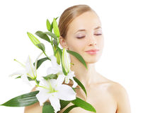 Beautiful girl with lily flower on white Stock Image