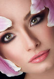 Beautiful Girl With Lily Flowers. Beauty Woman Face.Vogue Styled Fashion Portrait. Professional Make-up. Makeup Stock Photo
