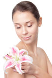 Beautiful girl with lily on shoulder Stock Photo