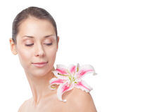 Beautiful girl with lily on shoulder Royalty Free Stock Photo