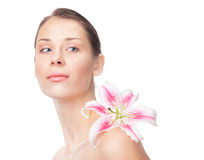 Beautiful girl with lily on shoulder Stock Images