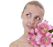 Beautiful girl with a lily on a spa procedure Royalty Free Stock Photography