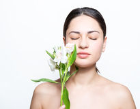 Beautiful girl with a lily in the spa Royalty Free Stock Images