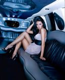 Beautiful girl in the limousine royalty free stock photos