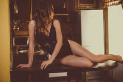 Beautiful girl in lingerie on the  table Royalty Free Stock Photo