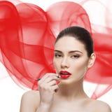 Beautiful girl with lip pencil Stock Photos