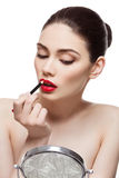 Beautiful girl with lip pencil Stock Images