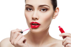 Beautiful girl with lipgloss Royalty Free Stock Photography