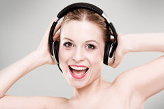 Beautiful girl is listen to the music Royalty Free Stock Image