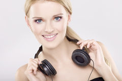 Beautiful girl is listen to the music Royalty Free Stock Photos