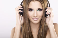 Beautiful girl is listen to the music Royalty Free Stock Images