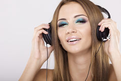 Beautiful girl is listen to the music Stock Photo