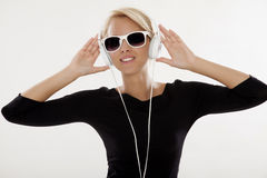 Beautiful girl is listen to the music. Beautiful adult sensuality blonde girl is listen to the music Royalty Free Stock Photo
