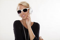 Beautiful girl is listen to the music. Beautiful adult sensuality blonde girl is listen to the music Stock Photography