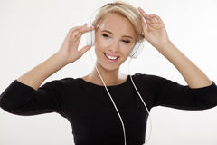 Beautiful girl is listen to the music Stock Images