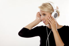 Beautiful girl is listen to the music Stock Photography