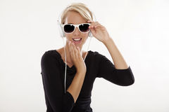 Beautiful girl is listen to the music Royalty Free Stock Photography