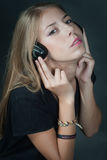 Beautiful girl listening music on headphones Stock Photos