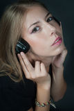 Beautiful girl listening music on headphones Royalty Free Stock Photography
