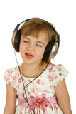 Beautiful  girl listening music in headphones Royalty Free Stock Photos