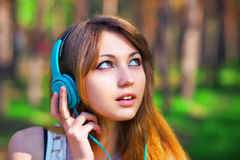 Beautiful girl listening music with headphones Royalty Free Stock Photo