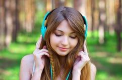 Beautiful girl listening music Stock Photo