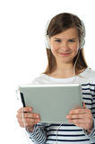 Beautiful girl listening to music Stock Images
