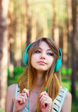 Beautiful girl listening to music with headphones Royalty Free Stock Photo