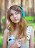 Beautiful girl listening to music with headphones Stock Photography