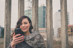 Beautiful girl listening to music in an urban context Royalty Free Stock Photos