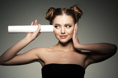Beautiful girl listens in the paper roll. Woman couting news and Stock Photo