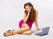 Beautiful girl listens to music Stock Photography