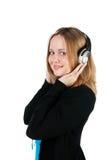 Beautiful girl listens to music Stock Photo