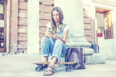 Beautiful girl listens to music on his smartphone Royalty Free Stock Photo