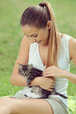 Beautiful girl and little cat Stock Photography