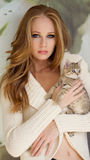 Beautiful girl with little kitty Stock Photography