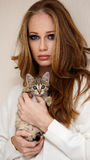 Beautiful girl with little kitty Royalty Free Stock Image
