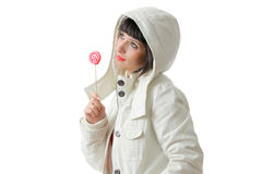 Beautiful girl with a lollipop. Isolated on white background Stock Photos
